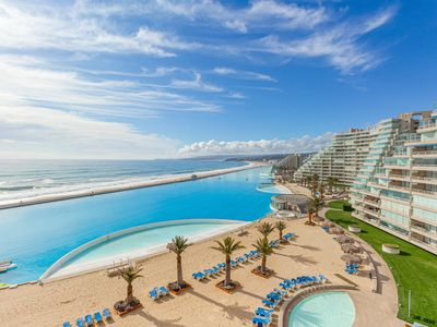 Photo for High-end, beachfront resort apt. w/ocean views & shared pool and more amenities!