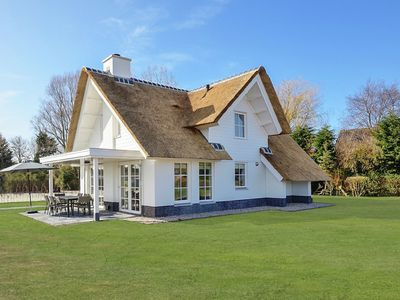 Photo for Spacious, thatch-roofed villas in a holiday park, just 1.5 km away from the North Sea beach.