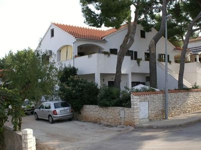 Photo for Two bedroom apartment with terrace and sea view Mirca, Brač (A-2902-b)