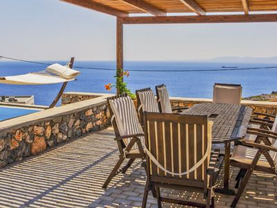 Photo for Beautifully designed with modern smart decor, inifinty pool and covered outdoor dining area with fantastic sea views. 5 minute drive to Pefkos village and beaches.