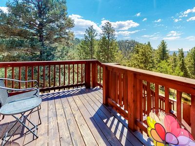 Photo for Charming, dog-friendly home w/ a full kitchen, furnished deck, & forest views
