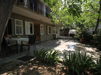 Photo for Two bedroom apartment with terrace Starigrad (Paklenica)