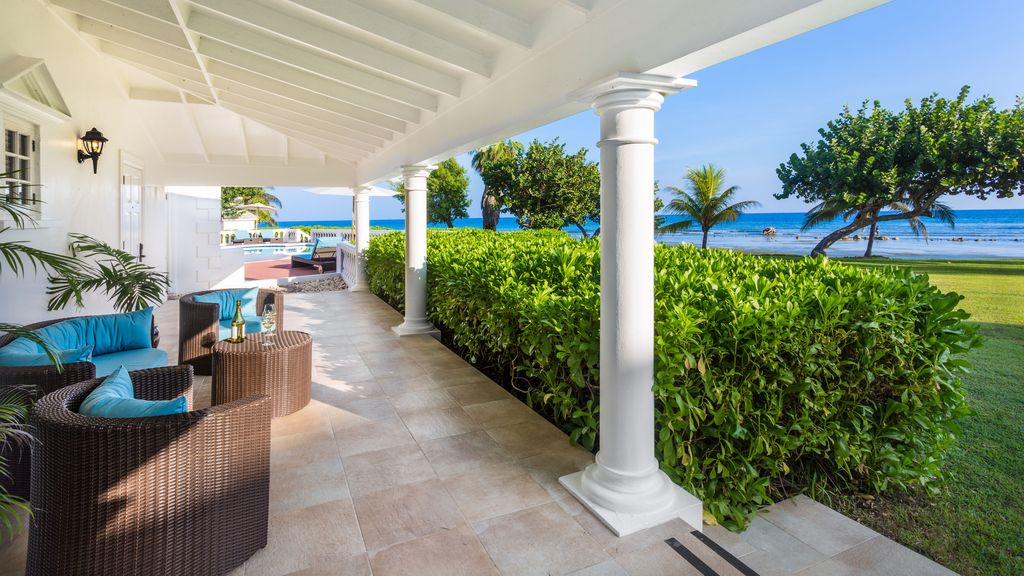 Serene, beachfront villa with resort access and amenities