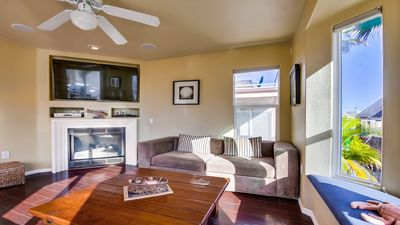 Living area on second level with large flat screen and fireplace