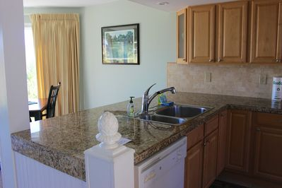 Upon entering, you will notice the renovated kitchen in this updated Spinnaker.