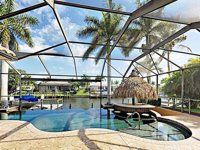 Photo for Waterfront 4BR - Infinity Pool, Swim-Up Bar, Screened Patio & Outdoor Kitchen