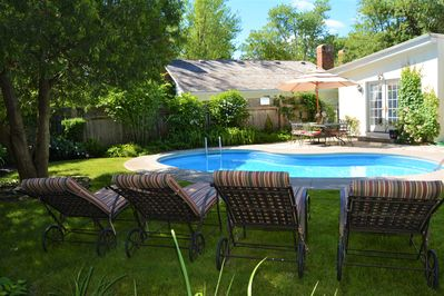 Avalon, Private oasis withe heated pool and dining area. Mature garden