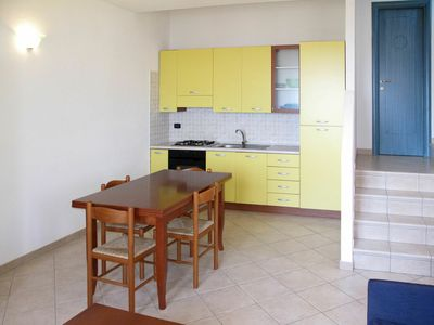 Photo for Cosy apartment for 4 people with A/C, pool, TV, pets allowed and parking