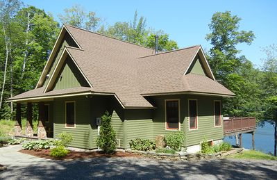 Photo for Custom built  lake front home on 5 acre, private, wooded lot near Stowe & Jay