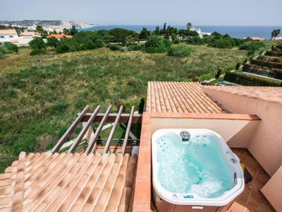 Photo for Mar da Luz two bedroom apartment with private roof terrace, hot tub and sea view