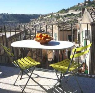 Photo for A charming holiday apartment with terrace and view on the beautiful baroque city of Modica in Sicily