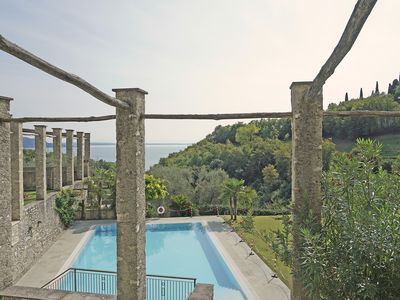Photo for Set in an elegant, modern location with lake and pool views.
