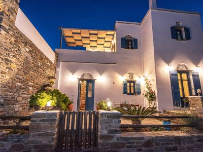 Photo for Traditional villa. Stone marble wood white and blue of Aegean Sea.Vineyards view