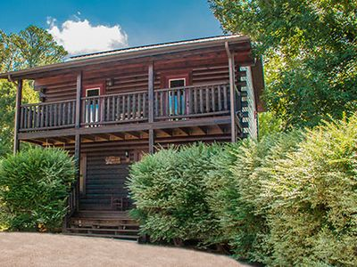 Photo for Beautiful 5 bedroom, 5 Bath log cabin in Pigeon Forge! Theater Room, Pool Table, View, Hot Tub, Arcade games.