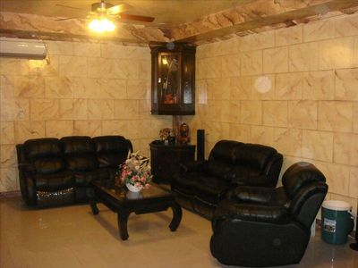 Living area, all chairs and sofa fully recline.
