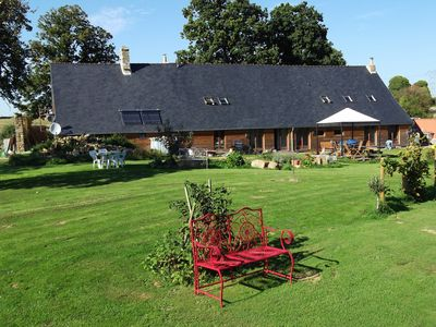 Photo for Farmhouse South facing sun deck Large grounds with pool childrens play equipment