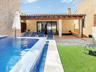 Photo for 5 bedroom Villa, sleeps 10 in Cala San Vicente with Pool, Air Con and WiFi