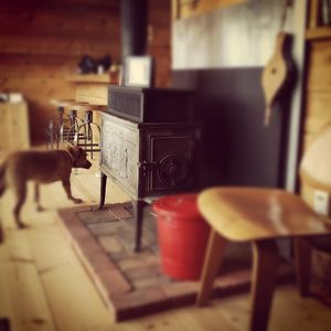 Wood stove in the living room.  Instagram #aframeflagstaff