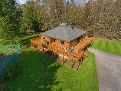 Photo for Log Hut- Lake Access Pet Friendly Home w/ Hot Tub & Lots of Outdoor Space