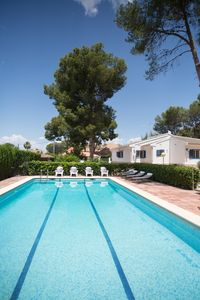 Large outdoor swimming pool, plenty of lounger and seating