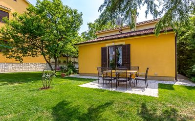 Photo for Magnificent holiday home only 700 meters to the sandy beach with kitchen, air conditioning, large garden with barbecue