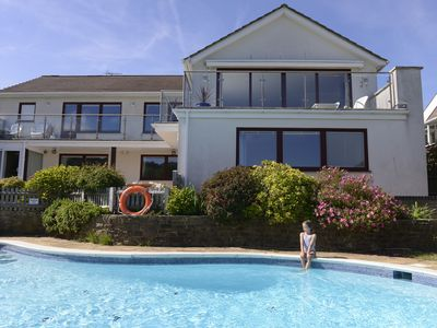 Photo for Beautiful family house with pool and views over golf course and South Downs