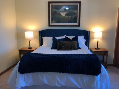 Romantic master  bedroom with queen pillow top bed and luxurious linens