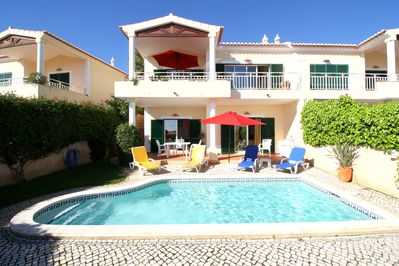 The rear of the south-facing semi-detached villa with private pool and sun patio