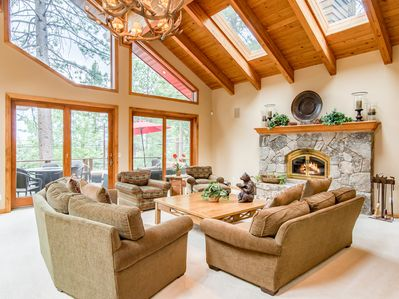 Main Living Area - Spend chilly nights snuggled up around this large wood-burning fireplace.