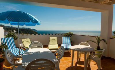 Photo for 1 Caves, beach and mountain! Fantastic ocean view with terraces and barbecues