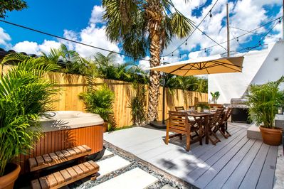 Outdoor dining area and hot tub