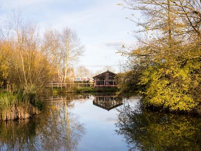 Photo for Luxury Wooden Lakeside Lodge CARRION Near Longleat