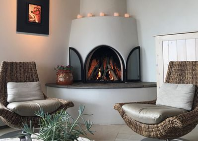 Gas fireplace - TV hidden in cabinet to the right.
