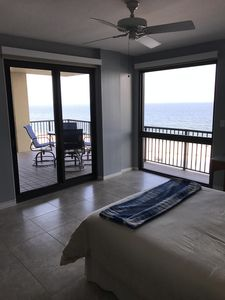 Master bedroom with 2 walls of glass overlooking the Gulf of Mexico.
