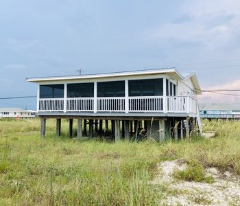 Photo for Gulf side beach cottage with tons of charm!