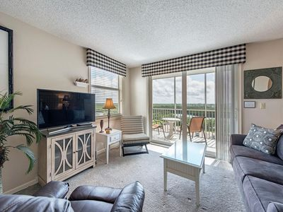 8th floor condo with a beautiful view of the back bay, tennis courts and pool