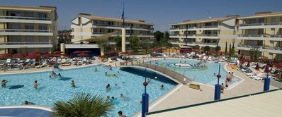 Photo for Holiday apartment with water slide and pool area