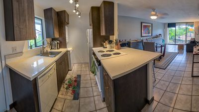 Photo for Fall Special Rate! Lovely end unit overlooking pool and green space