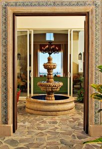 Lovely fountain in inside courtyard entrance welcomes you upon arrival
