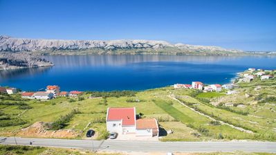 Photo for Two bedroom apartment with terrace and sea view Metajna, Pag (A-6389-a)
