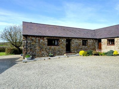 Photo for This attractive stone cottage is the end one of a group of three, in the owner's attractive, landsca
