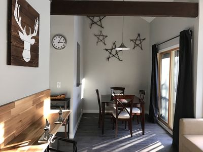 Dining Room.  USB charging outlets under the clock.