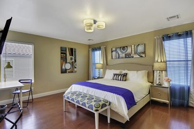 Master bedroom with a king size bed, desk