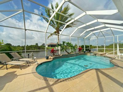 Photo for 33% OFF! -SWFL Rentals - Villa Ellis - Tommy Bahama Style Pool Home w/Gulf Access in NW Cape Coral