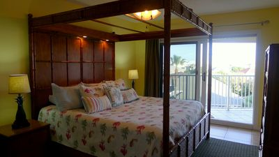 Master Bedroom with King Canopy Bed, Sliders to Balcony, Armoire-TV DVD Player