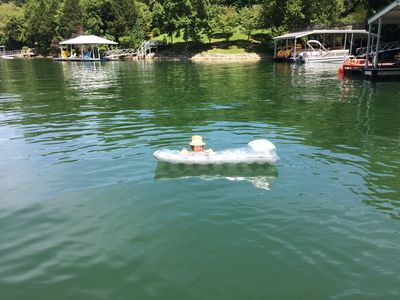 Enjoying our 'tucked in' location in our cove. In the water or lounging on dock.