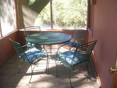 Screened porch is ideal for outdoor dining
