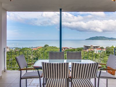 Photo for Modern condo with shared pool plus ocean & mountain views - close to town