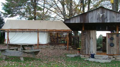 Tent on platform with covered deck + outdoor kitchen