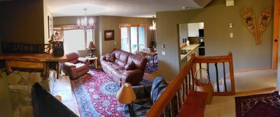 Living room, looking into kitchen and dining room
